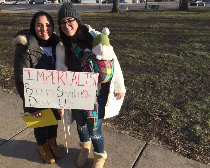 Rally organizers Sarah Masoud, 24, and Amanda Tallo, 27, with their sign as the protest concludes.