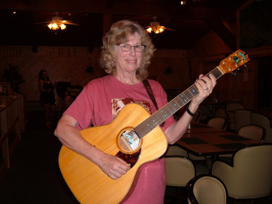 Pat Parr guitar with the mountain, trees and stream head inlay
