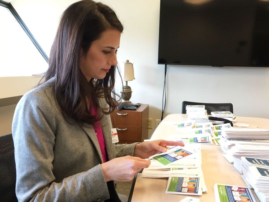 Thirty-three-year-old mother Kim Nelson started a vaccine advocacy group in Greenville, S.C., to help reach vaccine-hesitant families. Here, she prepares vaccine information flyers for public school students.