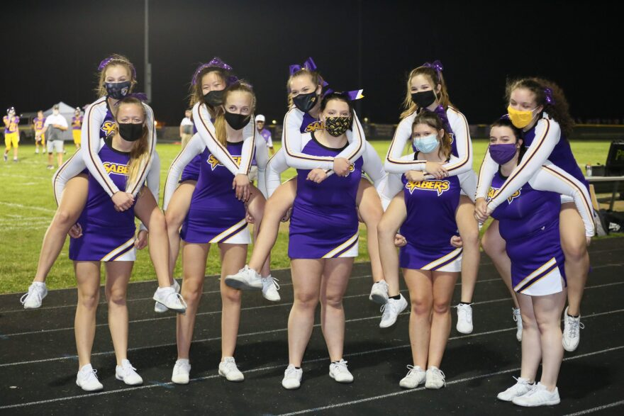 Cheerleaders wear masks at a socially distant high school football game in Clinton County, Iowa. (Scott Hoag Photography)
