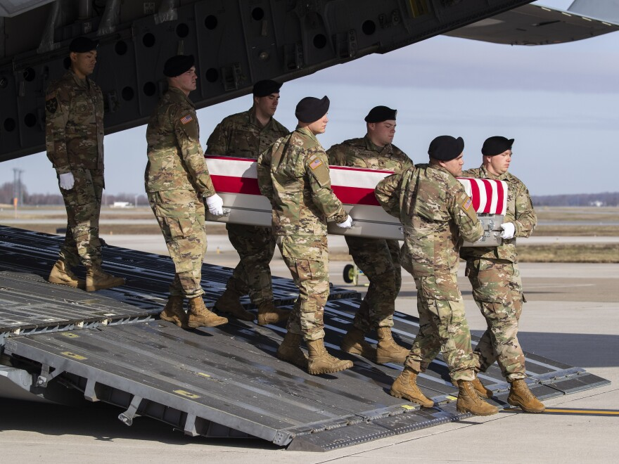 In this Dec. 25 photo, an Army carry team moves a transfer case containing the remains of U.S. Army Sgt. 1st Class Michael Goble, at Dover Air Force Base in Delaware. The U.S. Special Forces soldier died in Afghanistan this week while seizing a Taliban weapons cache.