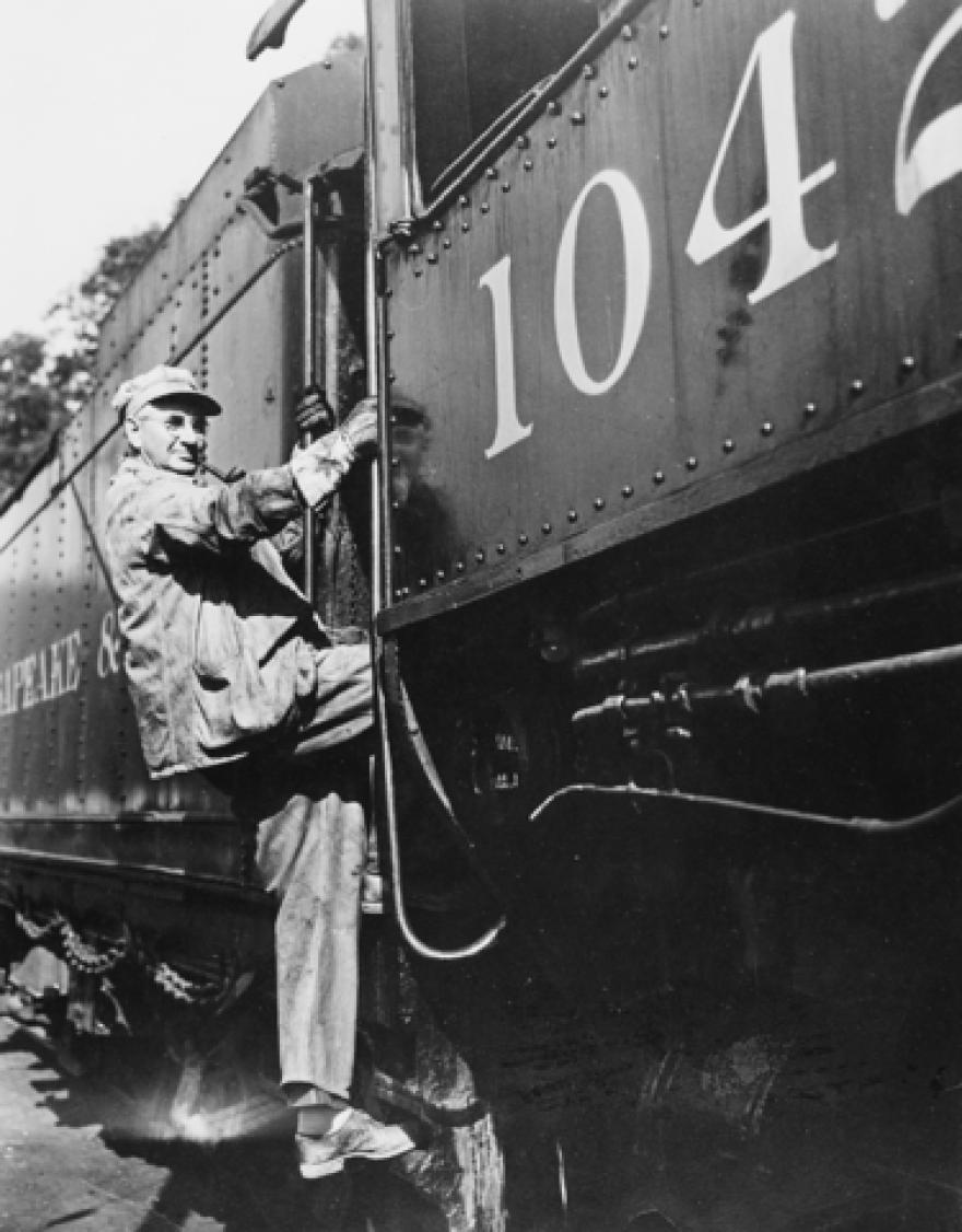Engineer William E. Bailey boards his C&O locomotive