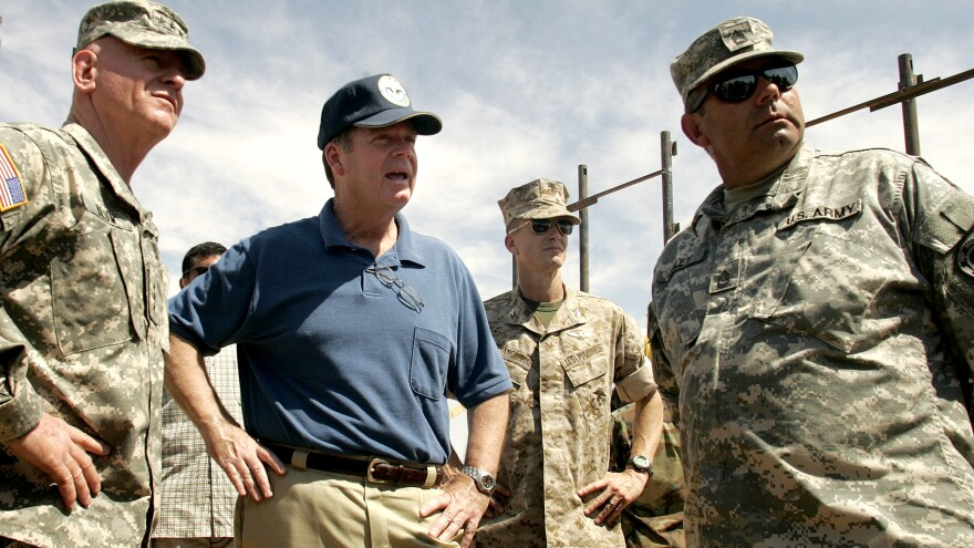 Retired Lt. Gen. H Steven Blum, left, and former assistant defense secretary Paul McHale, center, visit Utah National Guard troops as they extend a border fence in San Luis, Ariz., in 2006.