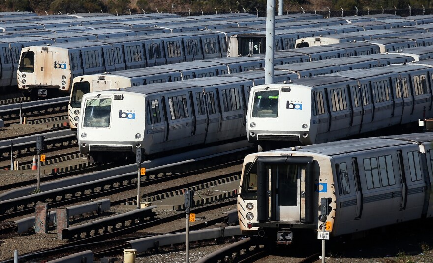 Bay Area Rapid Transit (BART) trains sit idle at a BART maintenance facility on the first day of the BART strike on October 18, in Richmond, Calif.