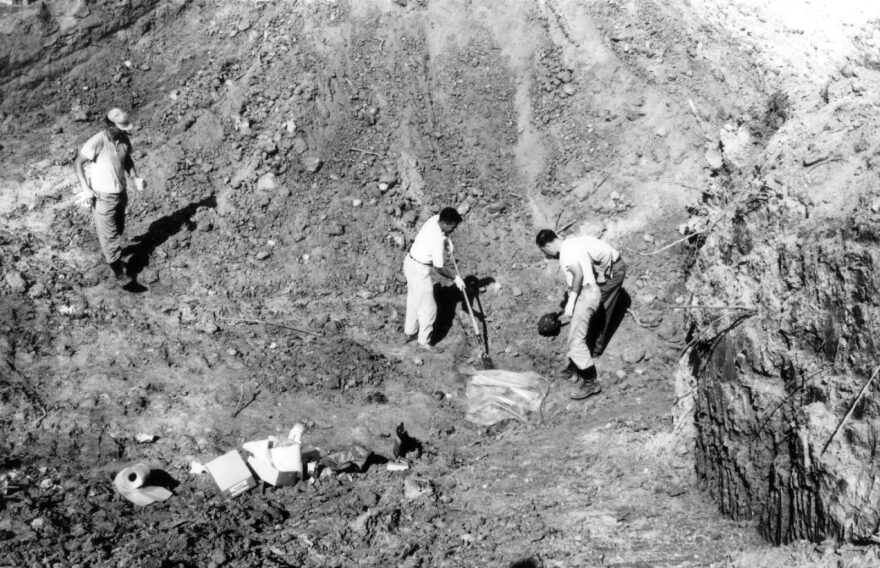 Investigators uncover the remains of civil rights volunteers Michael Schwerner, Andrew Goodman and James Chaney under thick red clay of an earthen dam near Philadelphia, Mississippi in July of 1964. The volunteers, all in their 20s, died at the hands of the Ku Klux Klan while working to register black voters during the Freedom Summer civil rights campaign.