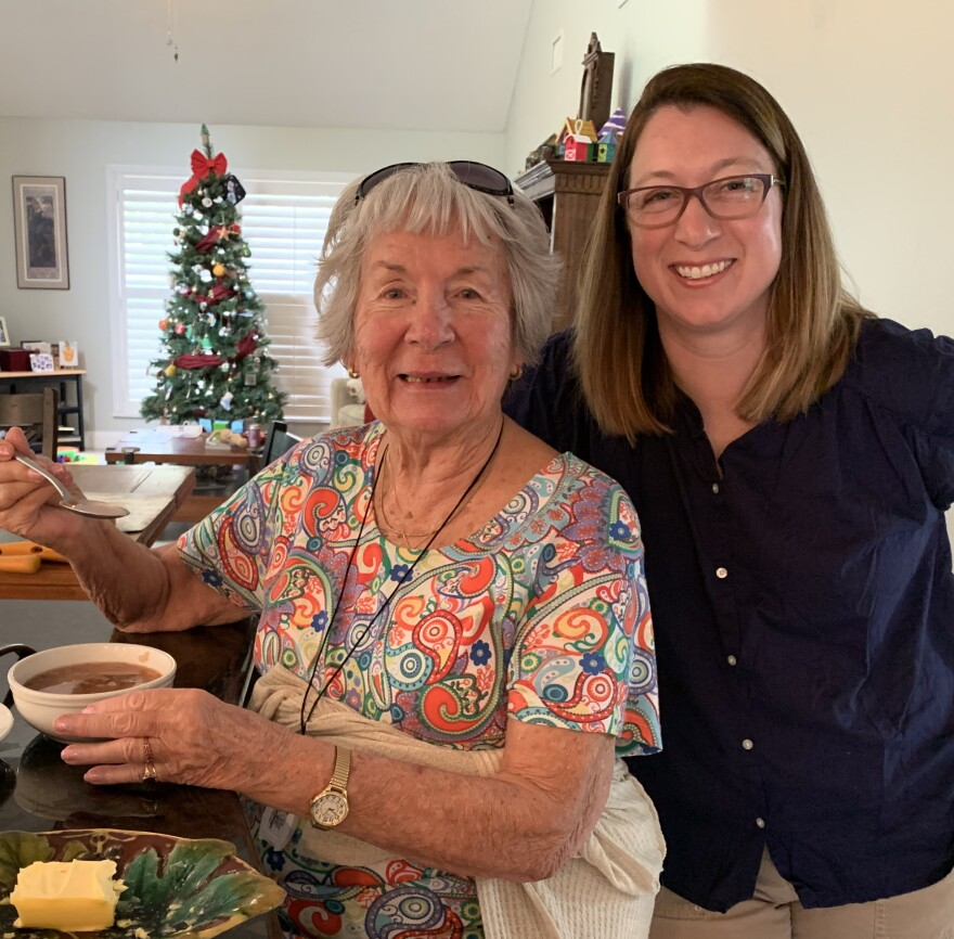 Olga Smith and her granddaughter, WUSF reporter Kerry Sheridan, sample some Borscht they just made.
