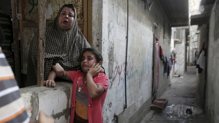 Palestinian relatives cry when mourners carry out the body of Baraa Mogdadm, 6, one of nine people killed in an explosion at a park in the northern Gaza Strip on Monday.