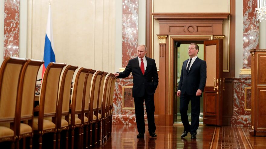 Russian President Vladimir Putin and Prime Minister Dmitry Medvedev speak before a meeting with members of the government Wednesday in Moscow. The Cabinet members resigned after Putin proposed a series of constitutional changes, according to Russian news agencies.