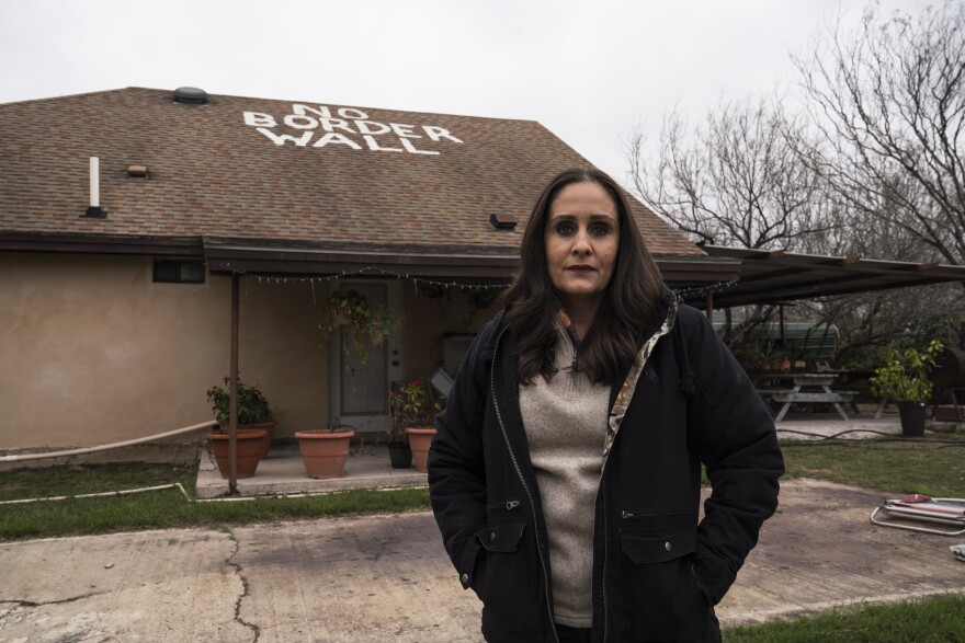 Nayda Alvarez poses for a photo in her backyard, which is part of the property that her family has owned for five generations along the Rio Grande on Feb. 9, 2019.