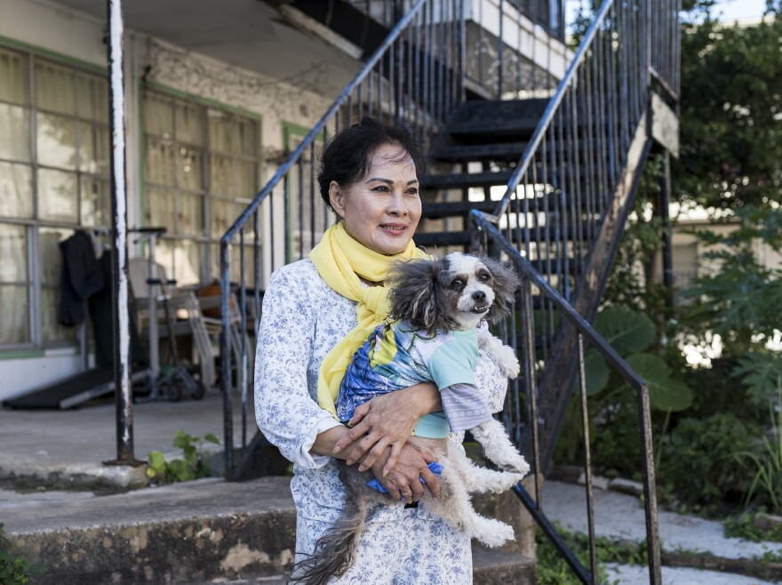 Hien Tran, 66, and her dog Lucy at the Thai Xuan Village apartment complex in Houston.