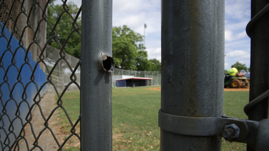 A bullet hole is seen on June 19 on a gate at the Eugene Simpson Stadium Park, the site where House Majority Whip Rep. Steve Scalise was shot by gunman James Hodgkinson, in Alexandria, Va.