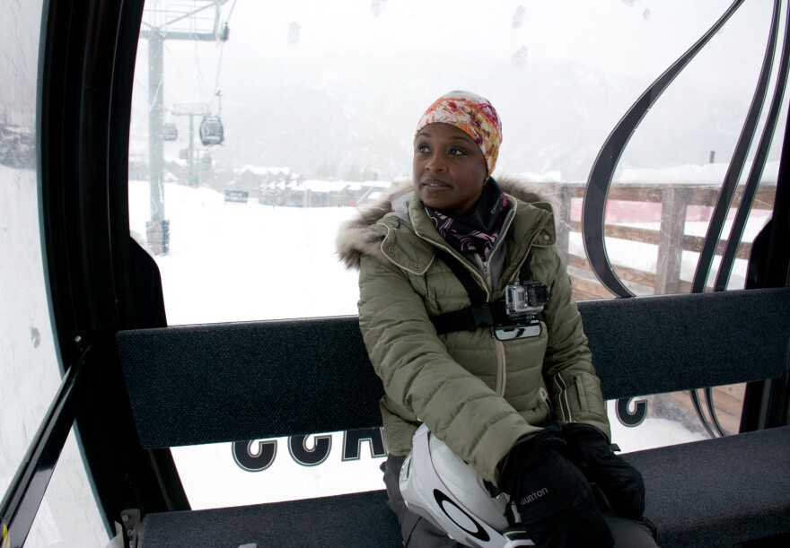 """Snowboarder Sophia Stallworth of Tampa, Fla., takes the gondola to a blue run Wednesday. Stallworth joined the National Brotherhood of Skiers four years ago. When she first tried skiing, she says, """"I didn't see people who looked like me."""" As youth director for Tampa's Onyx Club, she works with underprivileged children to develop their interest in outdoors sports."""