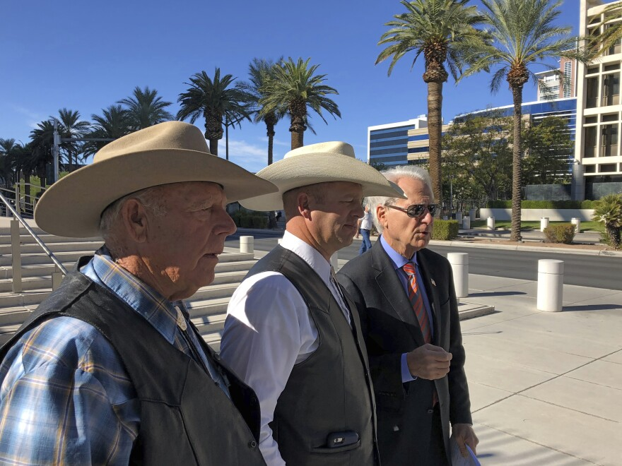 A federal appeals court has confirmed the dismissal of a criminal case against Nevada rancher Cliven Bundy (left), seen in 2018 with his son Ryan Bundy and attorney Larry Klayman.