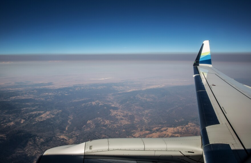 A thick layer of smoke from the Carr Fire settles over California's Central Valley in a view from a jet earlier this summer. Fine particulate matter from drifting wildfire smoke mixes with industrial ozone and can become trapped between the mountain ranges.