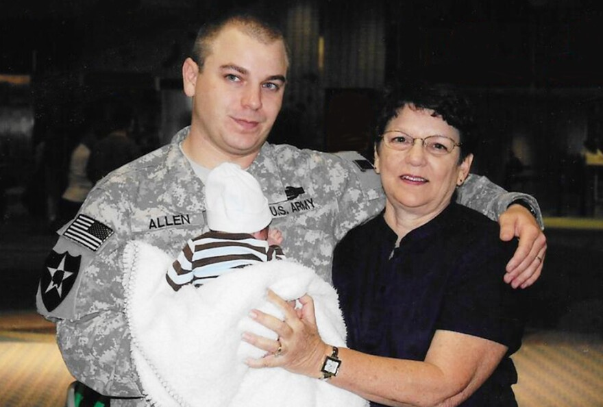 Cathy Sprigg (right) with her son, Army Spc. Robert Joseph Allen, at Tampa International Airport in 2010. Allen was headed back to Iraq after being on leave for the birth of his son.
