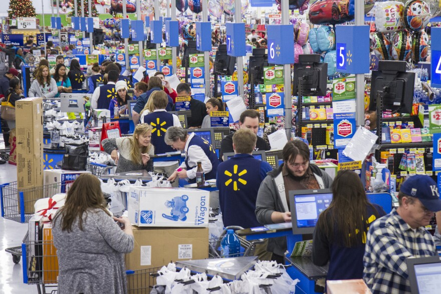 Customers wrap up their holiday shopping during Walmart's Black Friday events on Thursday, Nov. 27, 2014 in Bentonville, Ark. Deep savings continue at Walmart Friday though Cyber Monday as part of five days of events in stores and online. (Photo by Gunnar Rathbun/Invision for Walmart/AP Images)
