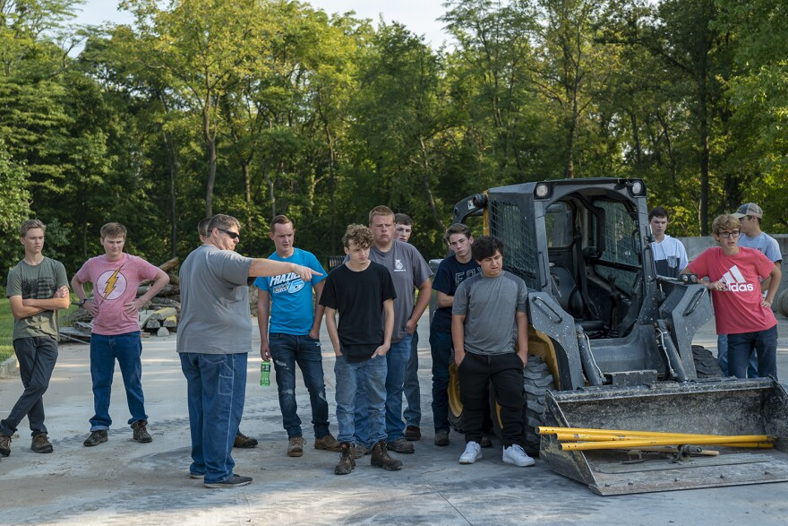 Instructor Jason Jackson explains the different challenges of pouring concrete to his class on Sept. 10.