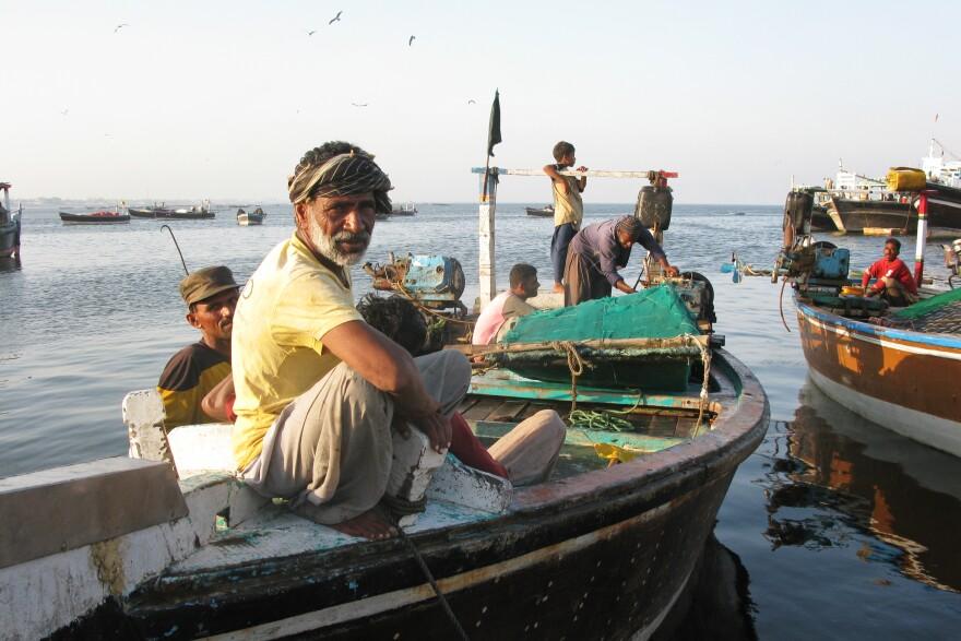 A Gwadar fisherman relaxes as the sun goes down.