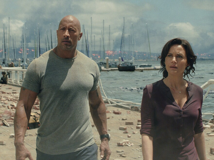 Dwayne Johnson and Carla Gugino survey the post-earthquake wreckage.