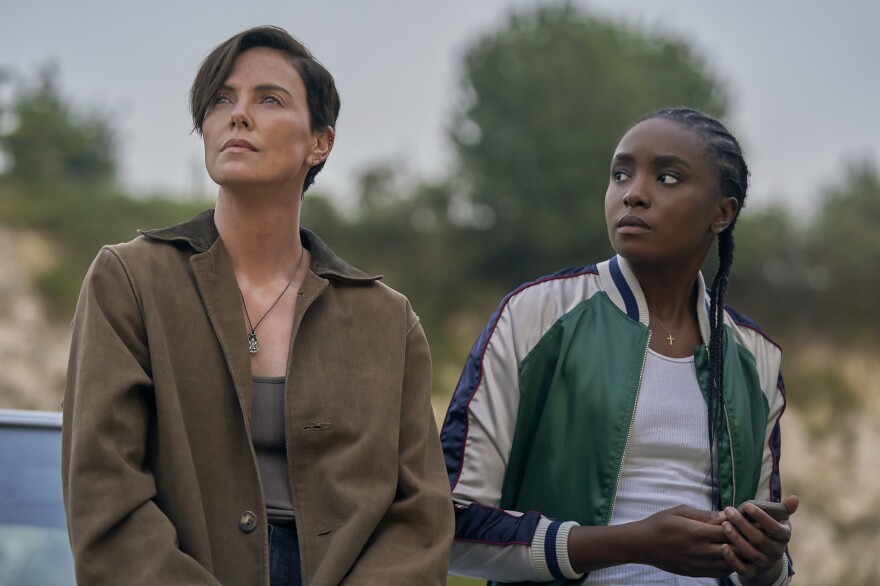 Andy (Charlize Theron) and Nile (Kiki Layne) star in <em>The Old Guard, </em>a new Netflix adaptation of Greg Rucka's comic book.
