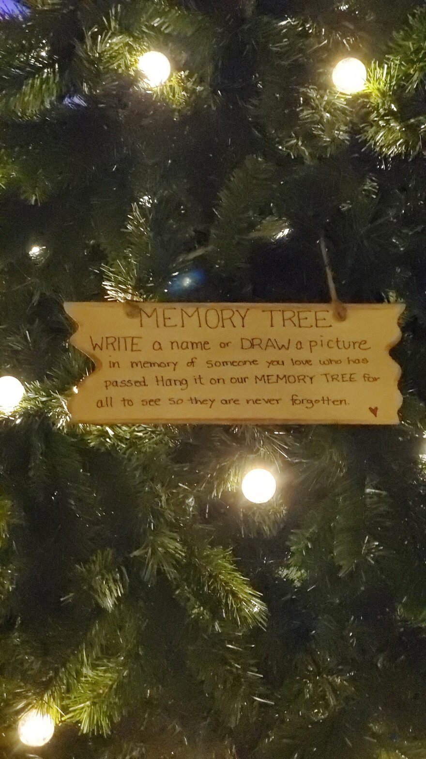 """Maya Robinson-Napier's """"memory tree"""" features  handmade ornaments commemorating those the family has lost this year as well as blank ornaments for neighbors and strangers to add."""