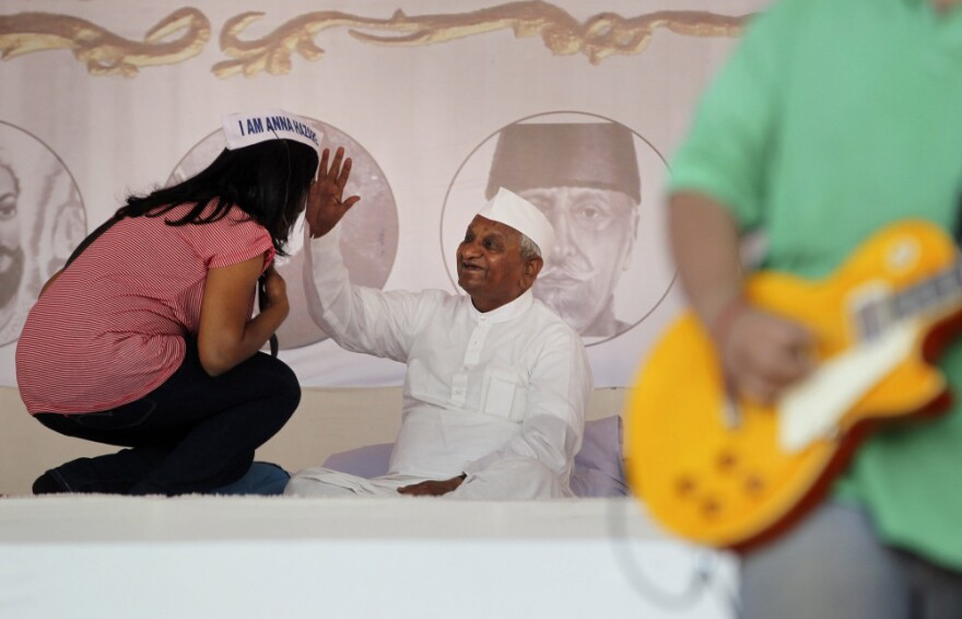 A supporter receives blessings from Indian anti-corruption activist Anna Hazare during the first day of Hazare's hunger strike, in Mumbai, India on Tuesday.