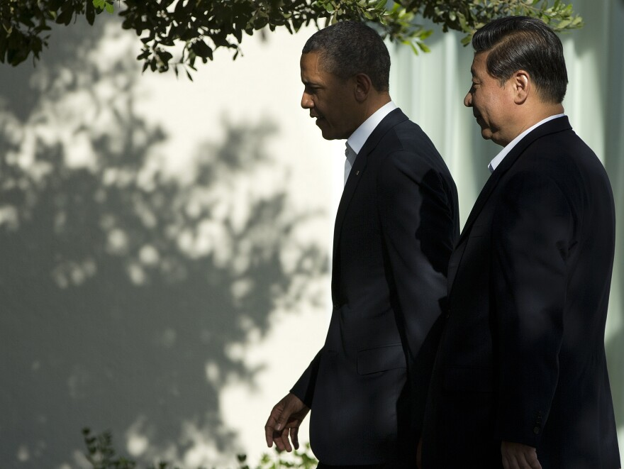 President Obama walks with Chinese President Xi Jinping at a retreat on Friday in Rancho Mirage, Calif., where the two leaders are meeting for talks.