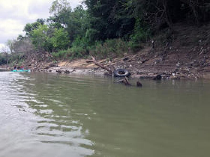 Tires and other debris in the Trinity River.