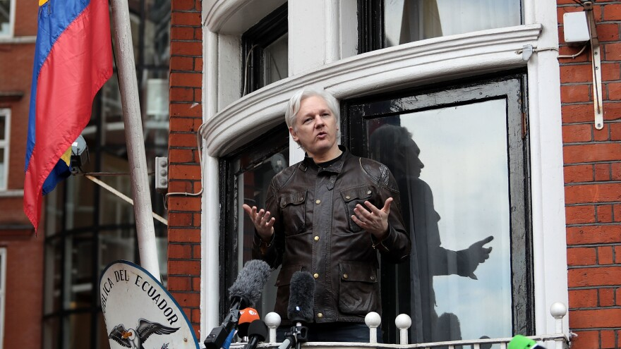 Julian Assange speaks to the media from the balcony of the Embassy of Ecuador on May 19, 2017, in London.