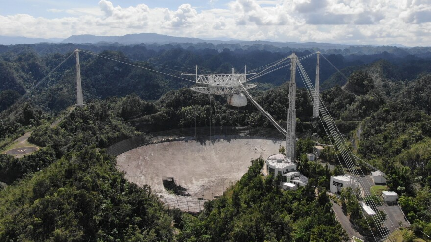 Arecibo Observatory's mammoth telescope collapsed overnight. It's seen here in November, after a cable damaged its dish.