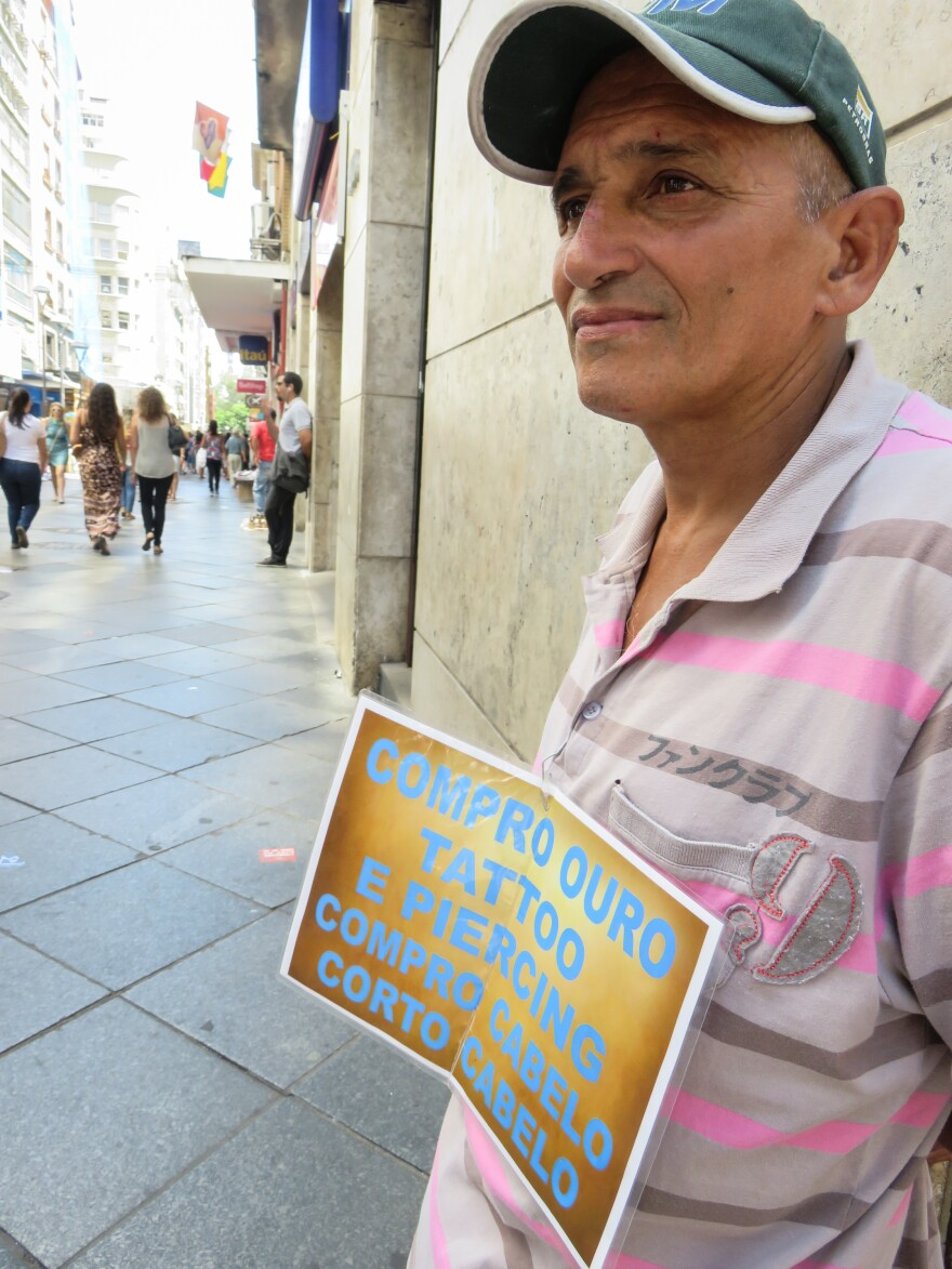 Carlos Roberto Gomes buys gold — and human hair — on a street corner in downtown Porto Alegre.