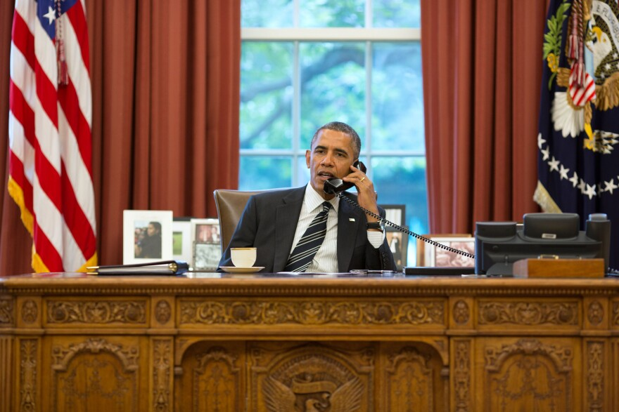 President Obama talks with President Hassan Rouhani of Iran during a phone call in the Oval Office, Sept. 27, 2013.