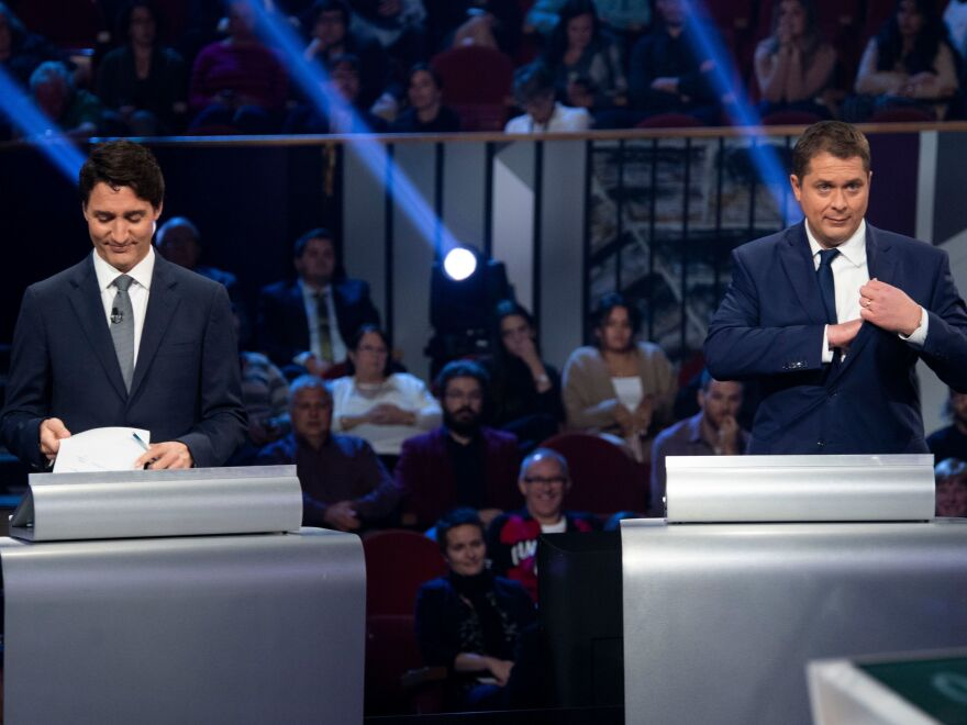 Justin Trudeau (left) and Conservative leader Andrew Scheer take part in a debate at the Canadian Museum of History in Gatineau, Quebec, on Oct. 10.