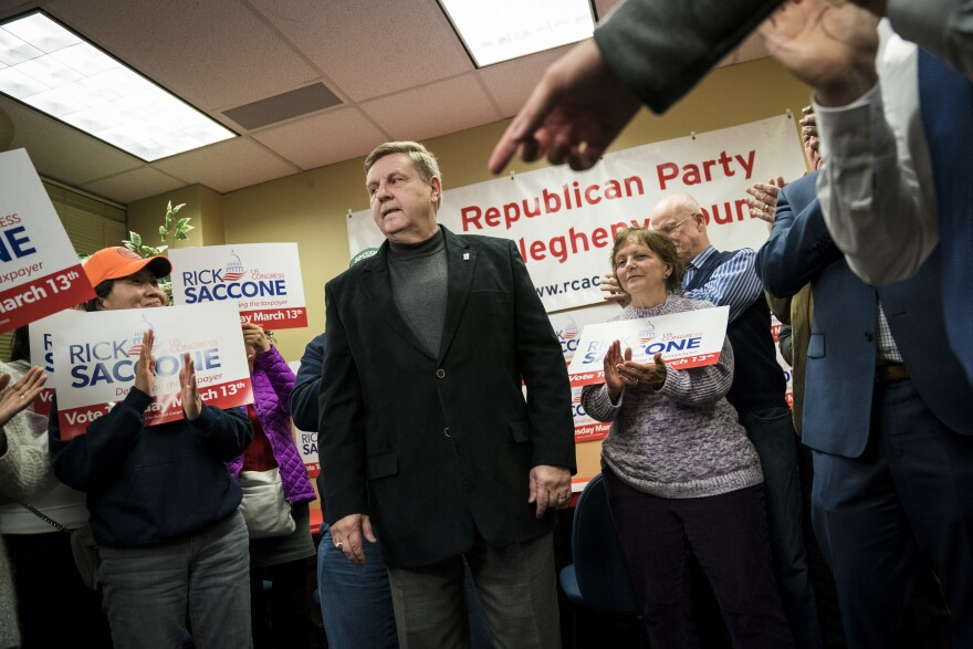 Rick Saccone, Republican candidate for Pennsylvania's 18th Congressional District, takes questions form reporters last week in Pittsburgh. Saccone has needed millions of dollars in spending from Republican allies to stave off a strong challenge from the Democratic candidate, Conor Lamb.