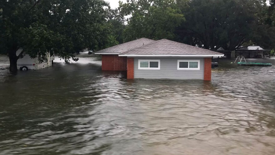 In this photo provided by the Chambers County Sheriff's Office, floodwaters surround a home in Winnie, Texas, after Imelda raked the area.