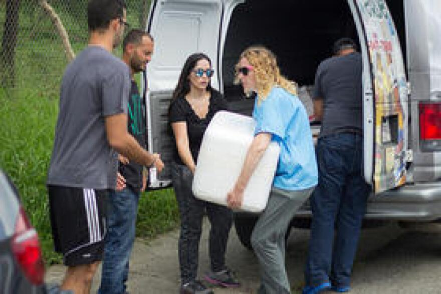 Dr. Perez-Colon and Dr. Oxner load a chest of refrigerated insulin into a van in Ponce, Puerto Rico.