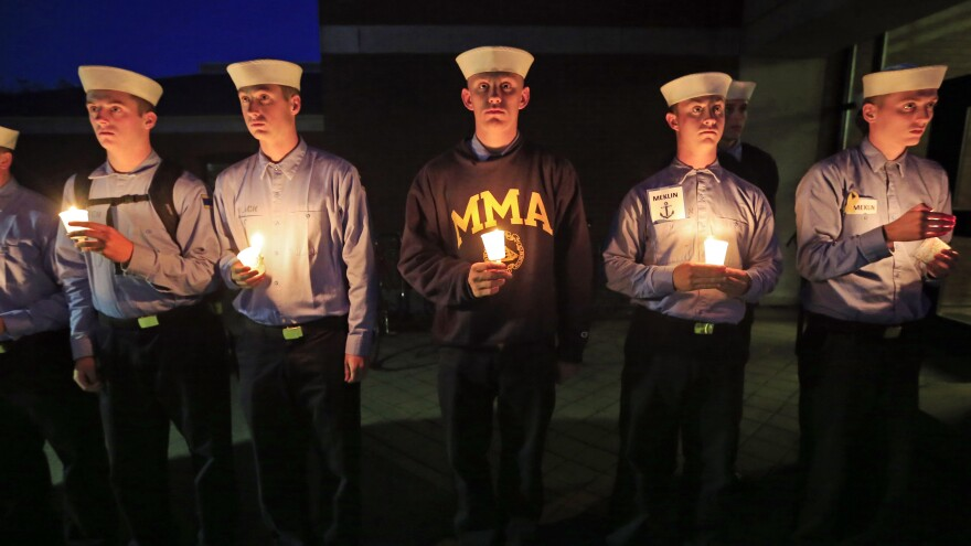 Maine Maritime Academy students attend a Tuesday evening vigil of hope for the missing crew members of the U.S. container ship El Faro.