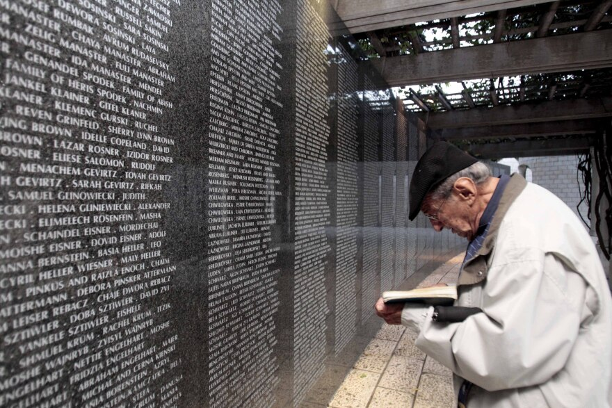Arnold Meyer, 90, prays at the Memorial Wall for his parents, and sister who died in the holocaust, during the commemoration of the 73rd Anniversary of Kristallnacht, Night of Broken Glass, in Miami Beach, Fla., Thursday, Nov. 10, 2011. In the early hours of Nov. 10, 1938 and continuing through nightfall 91Jews in Germany were killed by Nazi German soldiers and thousands of Jews men were taken to concentration camps.