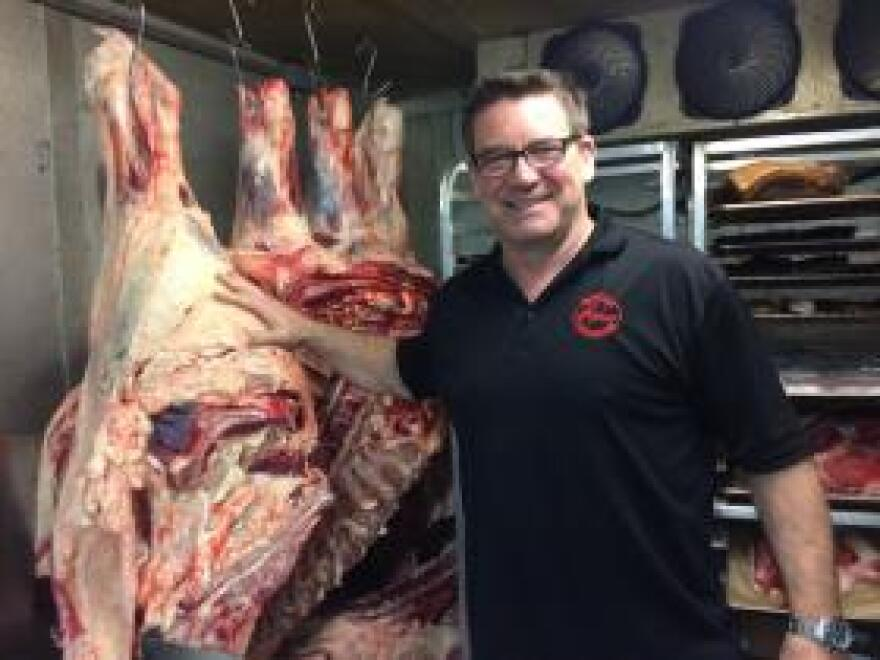 In a meat locker in the basement of his Kansas City restaurant, Anton Kotar show off the sides of grass-fed beef that become the steaks he features on his menu.