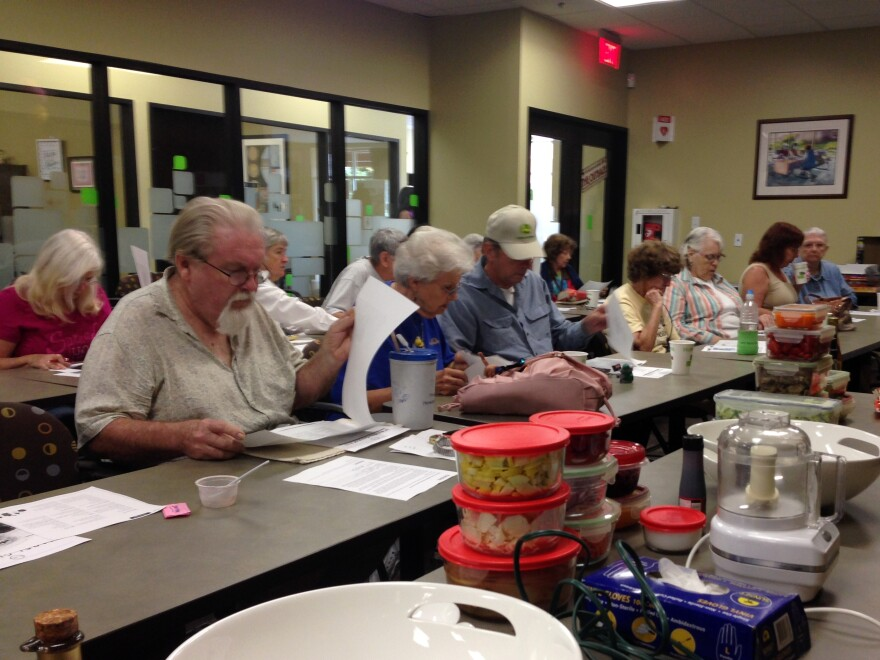 Participants in a healthy cooking class with Chef Mabel Guzman.