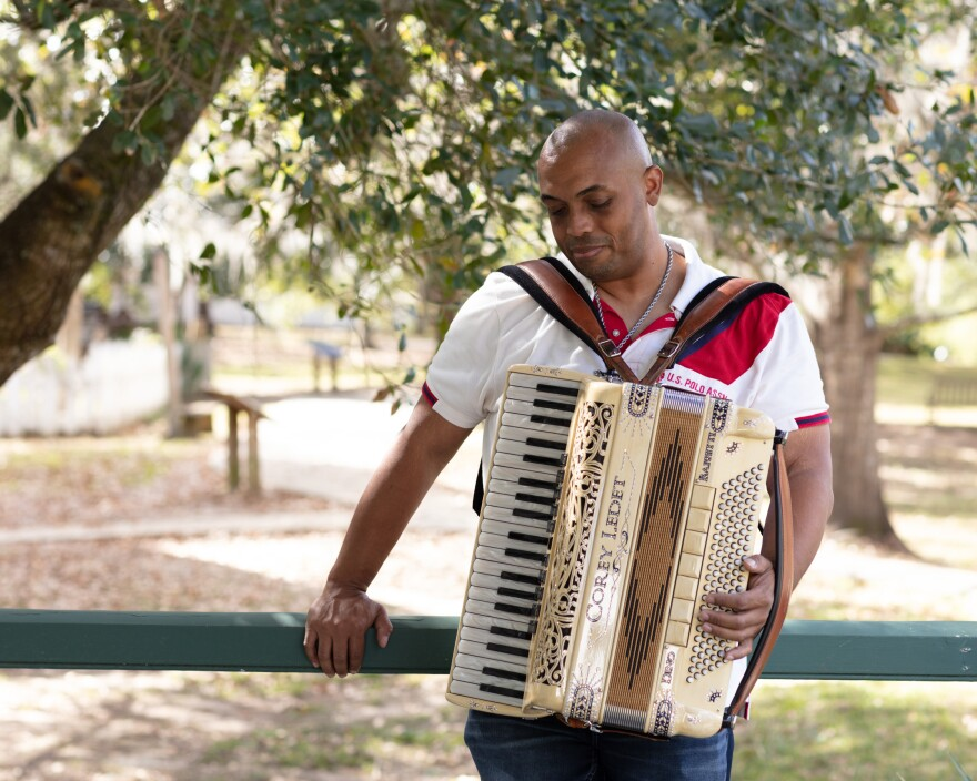 Zydeco musician Corey Ledet holds his piano accordion before a rare live show in Lafayette, La.