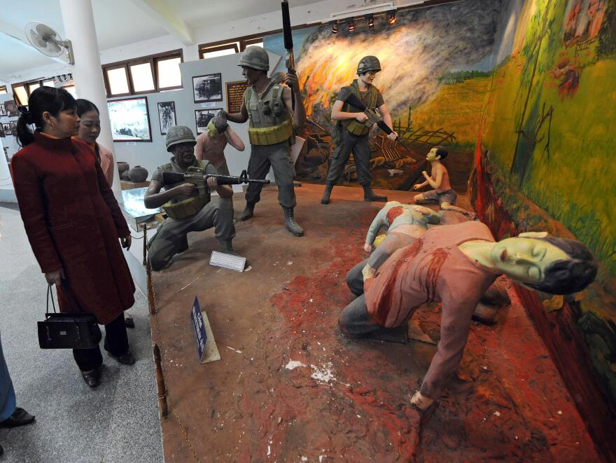 Visitors take in a re-created scene at the massacre museum at Vietnam's My Lai village. Researcher Nick Turse says atrocities of all kinds were more common in the Vietnam War than most Americans believe.