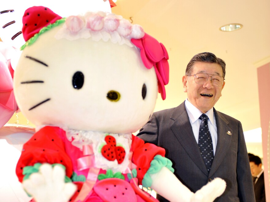 Sanrio founder Shintaro Tsuji poses with Hello Kitty in 2009 as the company opens the world's largest Sanrio shop in Tokyo.