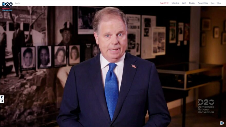 In this screenshot from the DNCC's livestream of the 2020 Democratic National Convention, Sen. Doug Jones (D-AL) addresses the virtual convention. The convention was once expected to draw 50,000 people to Milwaukee, Wisconsin, and is now taking place virtually due to the coronavirus pandemic.