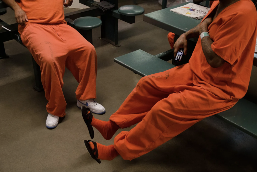 Inmates chat inside a cell block at the Harris County Jail.