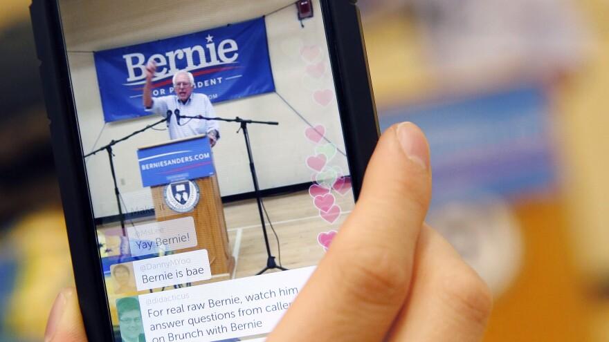 A campaign worker live-streams Sen. Bernie Sanders speaking in Nashua, N.H. in June 2015.