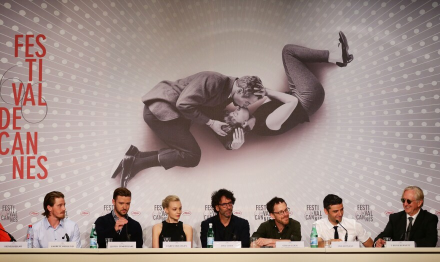 Actors Garrett Hedlund (from left), Justin Timberlake, Carey Mulligan, directors Joel and Ethan Coen, Oscar Isaac and T-Bone Burnett attend the <em>Inside Llewyn Davis</em> press conference at the Cannes Film Festival on May 19.