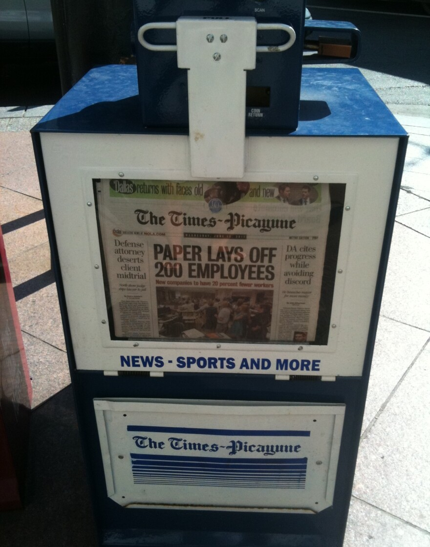 A New Orleans newspaper stand holds copies of Wednesday's <em>Times-Picayune</em>, which announced layoffs for 200 employees.