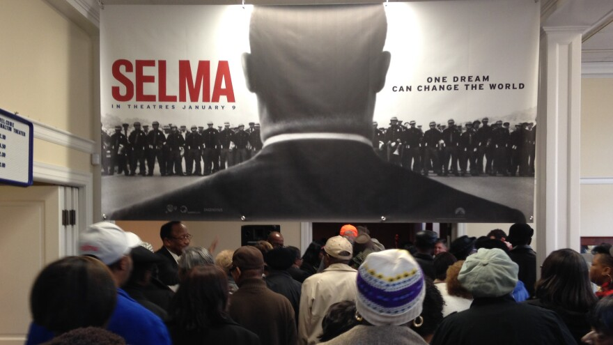 Selma residents, many with firsthand connections to the city's civil rights movement, file into the Walton Theater for a free screening of <em>Selma</em>.