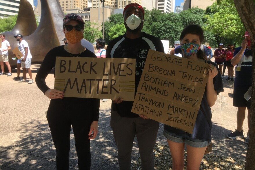 Hundreds participated in a silent protest at Dallas City Hall Thursday.